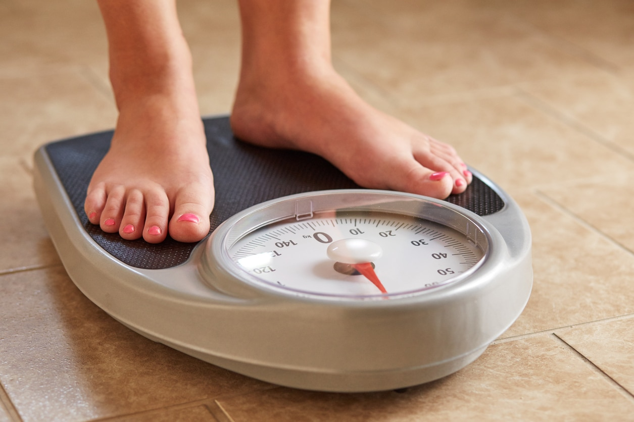 Female feet on weight scale